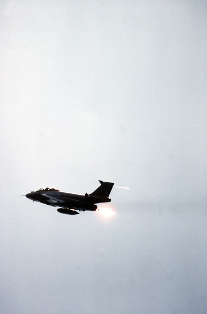 A left rear view of an F-101 Voodoo aircraft in flight. The aircraft is assigned to the 107th Fighter Interceptor Group, New York Air National Guard, North American Air Defense Command (NORAD)