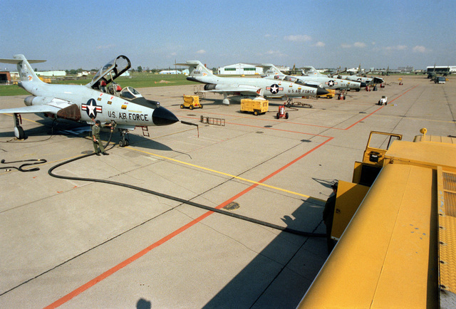 A right front view of F-101 Voodoo aircraft in a line while undergoing general maintenance. The aircraft are assigned to the 107th Fighter Interceptor Squadron, New York Air National Guard, North American Air Defense Command (NORAD)