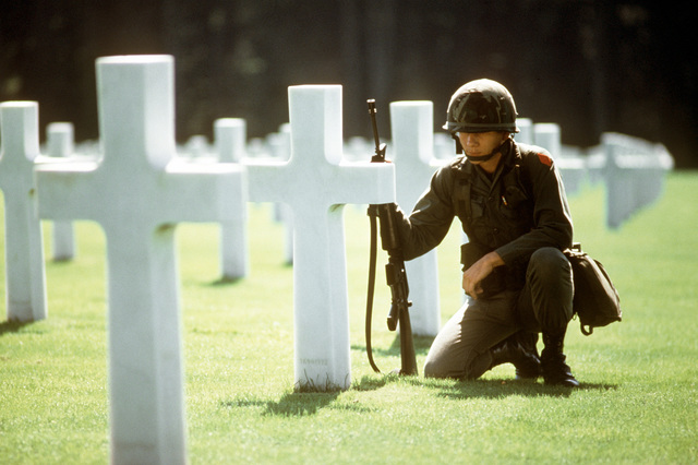 An American Army soldier pays his respects to the fallen comrades of World War II in the American cemetery in Luxembourg. Exact Date Shot Unknown