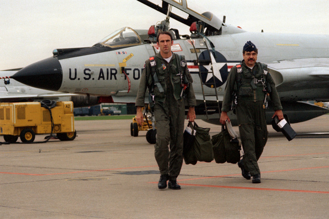 F-101 Voodoo aircraft pilot leave their aircraft after a mission. The pilots are assigned to the 107th Fighter Interceptor Group, New York Air National Guard, North American Air Defense Command (NORAD)