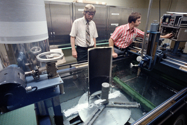 Materials engineer Lee Gulley and engineer Noel Tracy (left to right) perform an ultrasonic test of a graphite epoxy panel. The technicians work in the Materials Laboratory, Air Force Wright Aeronautical Laboratory, Air Force Systems Command