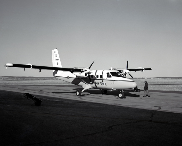 A right front view of a UV-18 aircraft parked on the flightline at the US Air Force Academy airfield. The Academy operates two of the aircraft as parachute jump planes