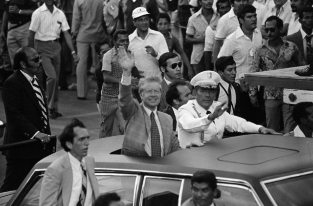 President Jimmy Carter, and General (GEN) Omar Torrijos wave at the crowds while riding in a motorcade downtown.  The president is in Panama to sign the Instruments of Ratification of the Panama Canal Treaty