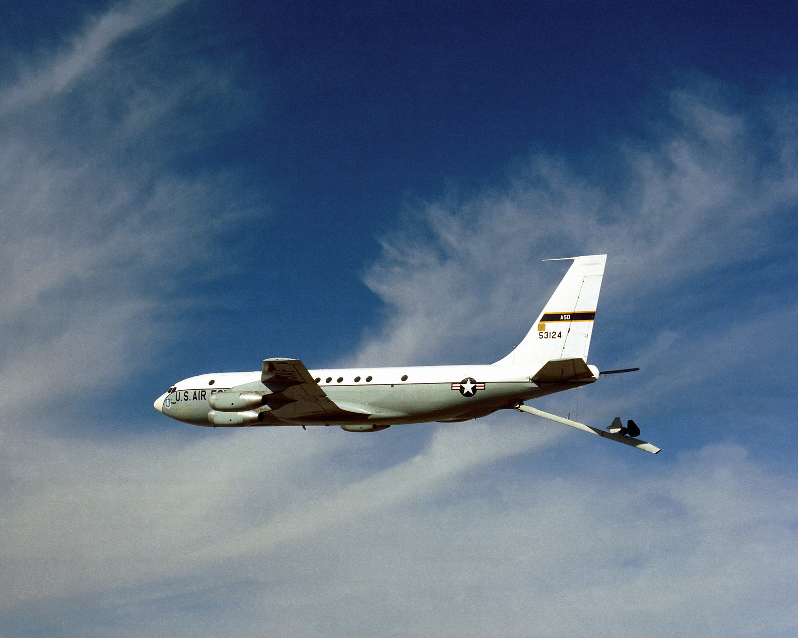 An air-to-air left side view of a KC-135A Stratotanker aircraft with the Advanced Aerial Refueling Boom extended