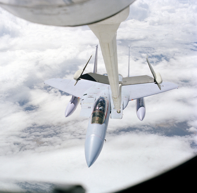 An air-to-air top view of an F-15 Eagle aircraft being refueled by a KC-135A Stratotanker aircraft. The view was taken from the Advanced Aerial Refueling Boom section of the KC-135A