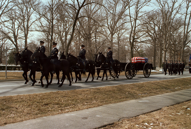 Honor Guard horse casket carriers lead the procession at Arlington National Cemetery during burial service for GEN Daniel (Chappie) James. Funeral services were conducted in the Shrine of the Immaculate Conception at Catholic University