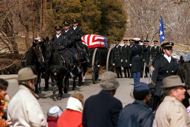 Honor guard horse casket carriers lead the procession at the Arlington National Cemetery during the burial services of GEN. Daniel (Chappie) James. The funeral was conducted in the Shrine of the Immaculate Conception at Catholic University
