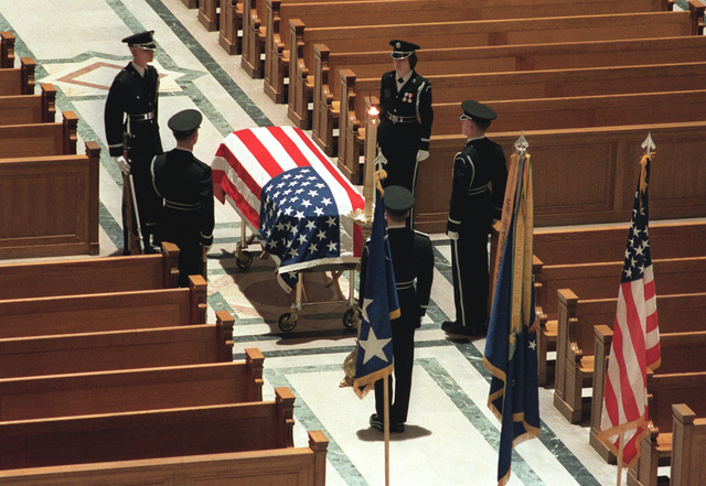 Honor Guard pallbearers watch over the casket on an aisle during the funeral of GEN Daniel (Chappie) James, being conducted in the Shrine of the Immaculate Conception at Catholic University