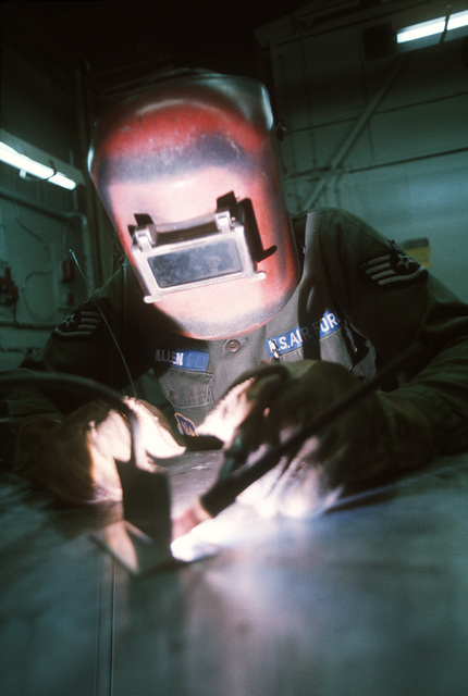 STAFF SGT. Walter R. Allen, a member of the 86th Field Maintenance Squadron, operates an arc welding torch