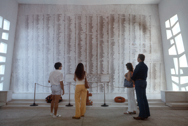 Personnel from the 508th Tactical Fighter Wing read the names of the men who served aboard the USS ARIZONA when the ship was attacked by Japanese aircraft on December 7, 1941