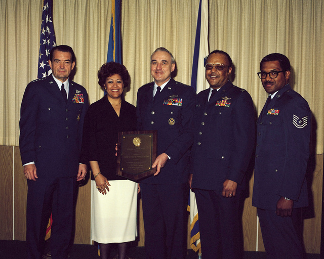 General (GEN) David C. Jones, Air Force chief of staff, and Mrs. Laura Brown present the 1977 Colonel (COL) L. Joseph Brown Award for the top major command social actions program to US Air Force Europe (USAFE) in a ceremony at the Pentagon. Receiving the award are, from left, Lieutenant General (LGEN) John W. Pauly, vice commander in chief, USAFE; COL Chester A. Beverly, chief of social actions, USAFE; and Techincal Sergeant (TSGT) Anthony J. Mills, drug and alcohol abuse control technician, USAFE