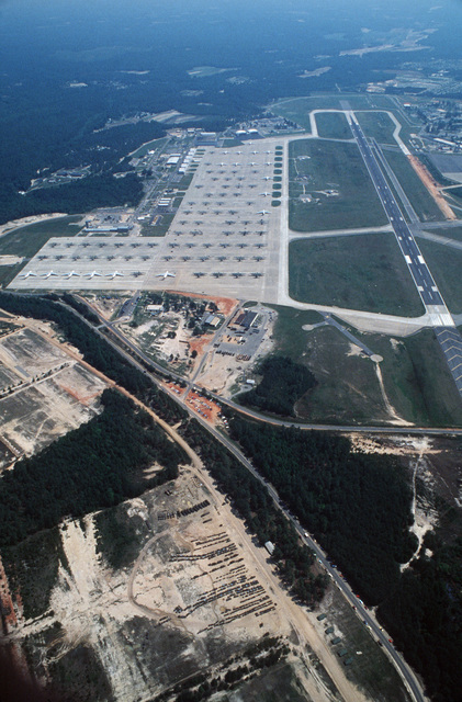 An aerial view of the base showing aircraft on standby and personnel and equipment of the 82nd Airborne Division in position to await loading instruction during the Zaire alert