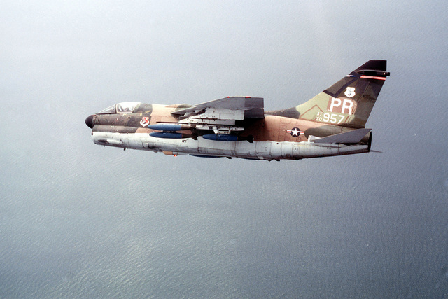 An air-to-air left side view of a Puerto Rico Air National Guard A-7D Corsair II aircraft during Exercise Solid Shield '78. The aircraft is armed with Mark 82 500-pound bombs