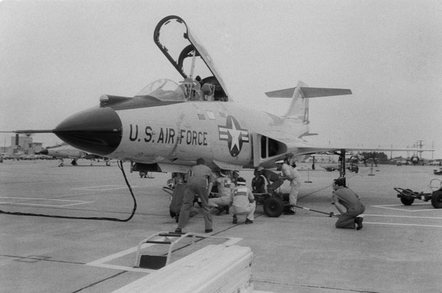Inspectors observe closely as personnel of the 147th Fighter Interceptor Group check meter readings on a training version of an AIR-2 Genie missile aboard an F-101 Voodoo aircraft during 1978 North American Air Defense Command Weapons Loading Competition