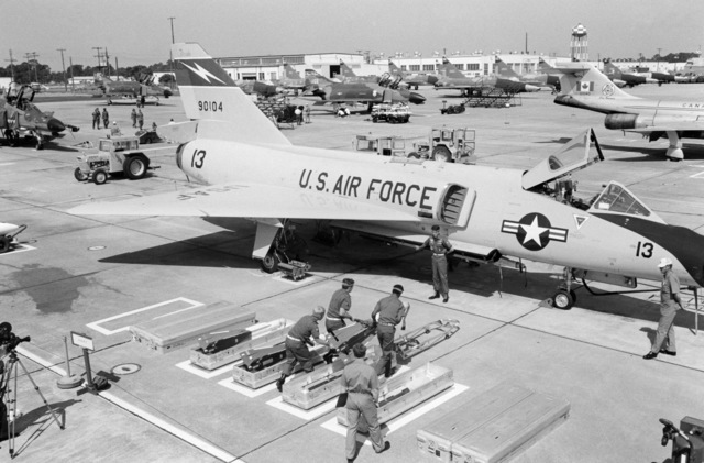 Personnel of the Air Defense Weapons Center carry an AIM-4G Super Falcon missile that will be loaded aboard an F-106 Delta Dart aircraft during the 1978 North American Air Defense Command Weapons Loading Competition