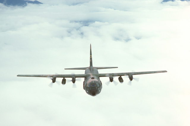 An air-to-air front view of a 36th Tactical Airlift Squadron C-130E Hercules aircraft