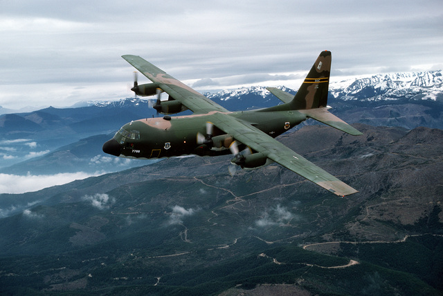 An air-to-air left front view of a 36th Tactical Airlift Squadron C-130E Hercules aircraft