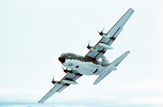 An air-to-air left underside view of a 36th Tactical Airlift Squadron C-130E Hercules aircraft