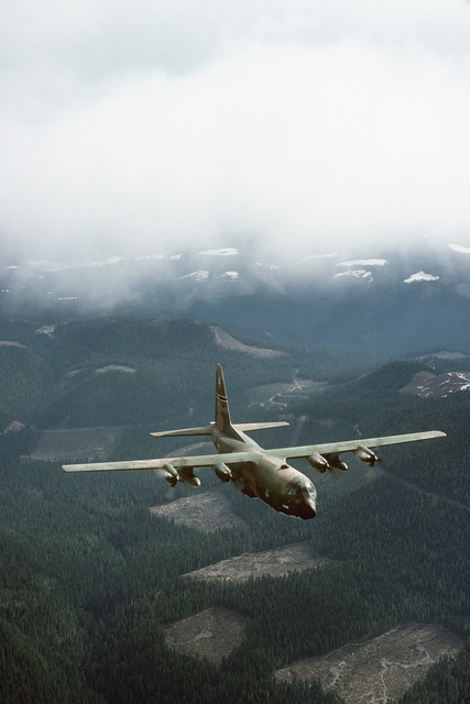 An air-to-air right front view of a 36th Tactical Airlift Squadron C-130E Hercules aircraft