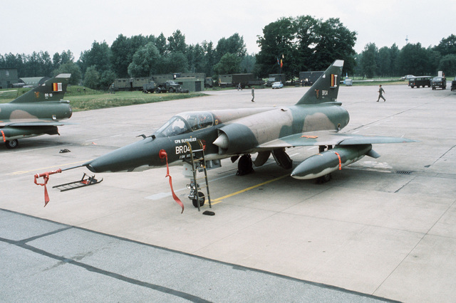 A left front view of a Belgian Mirage aircraft parked on the flight line during TACTICAL AIR MEET '78