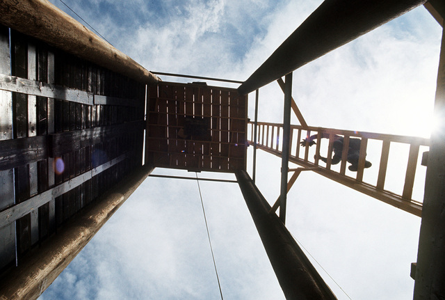 A member of the 1ST Battalion 7th Special Forces Group (Green Berets), Fort Bragg, North Carolina, climbs a rapelling practice tower during Joint Readiness Exercise BRAVE SHIELD XVIII