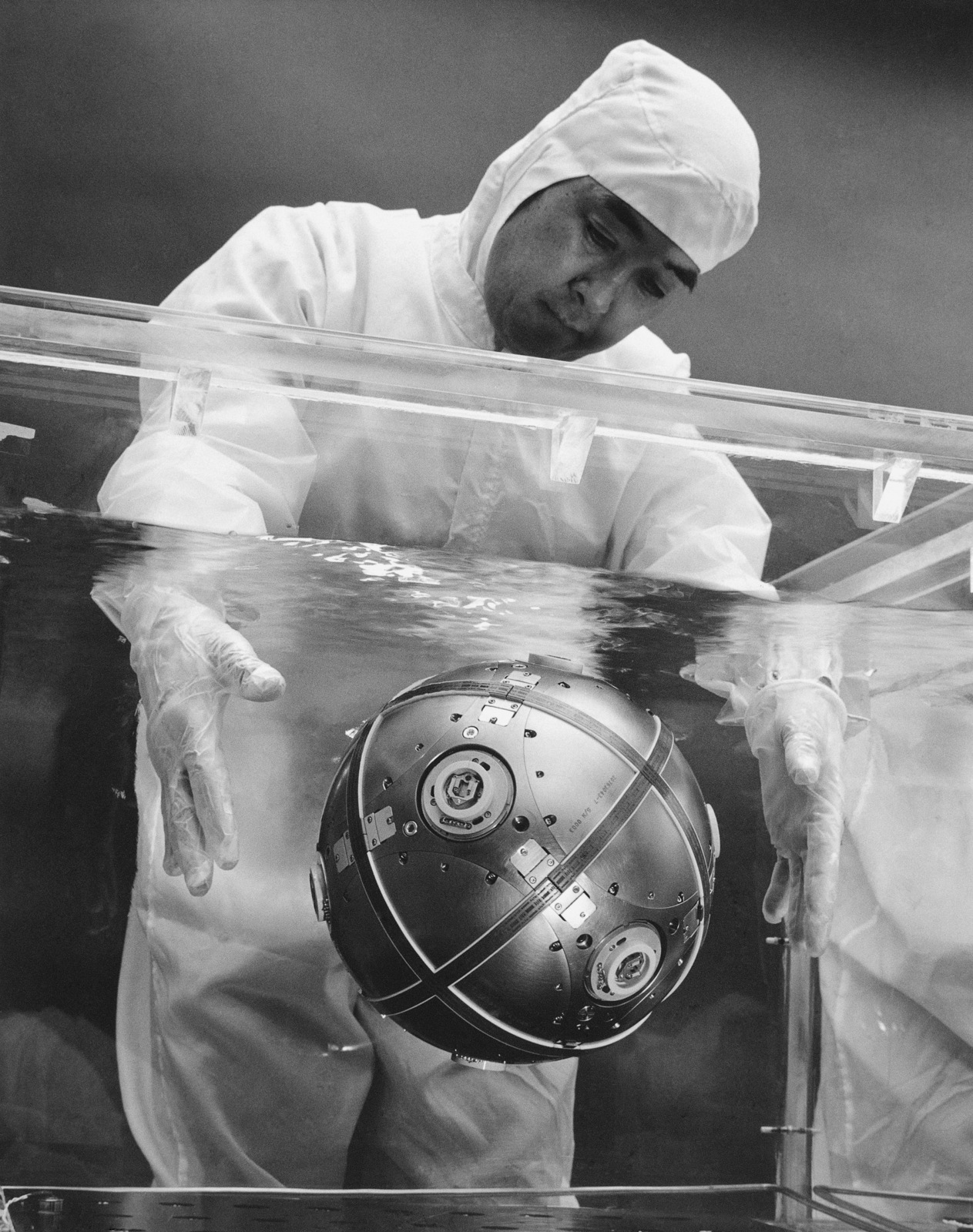 """A Northrop Corporation technician tests the buoyancy and balance of a """"floating ball"""" element of the new inertial guidance system being developed for the US Air Force's MX advanced intercontinental ballistic missile technology program"""