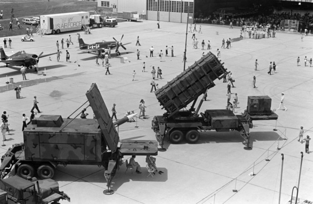 An AN/MPQ-53 multi-function guidance radar system, foreground, and an MIM-104A Patriot missile launcher on display during an open house at the base