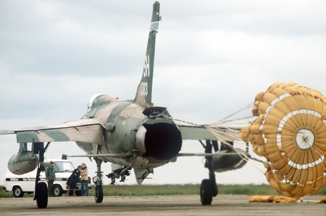 A 507th Tactical Fighter Group F-105 Thunderchief aircraft deploys a drag chute upon landing at the base
