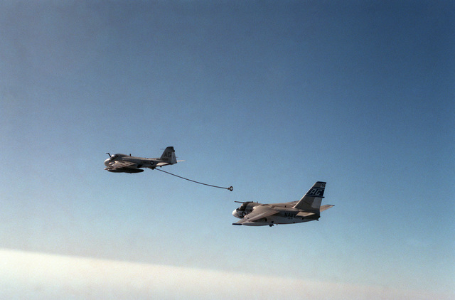 An air to air left side view of an Air Anti-submarine Squadron 31 (VS-31) S-3A Viking aircraft approaching the refueling drogue of a KA-6D Intruder aircraft
