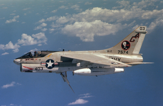 An air to air left side view of an Attack Squadron 12 (VA-12) A-7E Corsair II aircraft equipped with a buddy store for aerial refueling