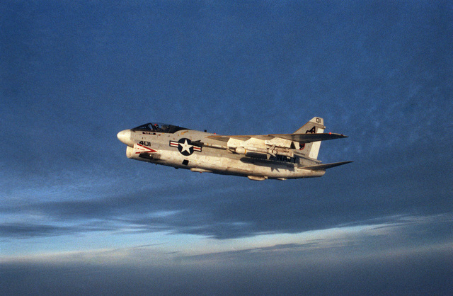 An air to air left side view of an Attack Squadron 12 (VA-12) A-7E Corsair II aircraft armed with an AGM 45 Shrike and an AIM-9 Sidewinder missile