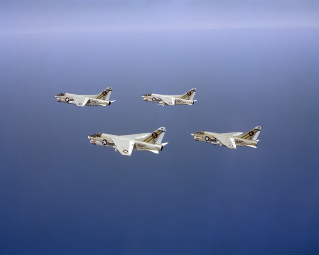 An air to air left side view of four Attack Squadron 66 (VA-66) A-7E Corsair II aircraft in formation