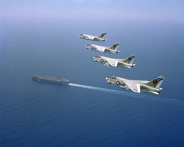 An air to air left side view of four Attack Squadron 66 (VA-66) A-7E Corsair II aircraft in formation above the nuclear-powered aircraft carrier USS DWIGHT D. EISENHOWER (CVN 69)