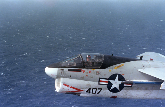 An air to air left side view of the forward section an Attack Squadron 12 (VA-12) A-7E Corsair II aircraft
