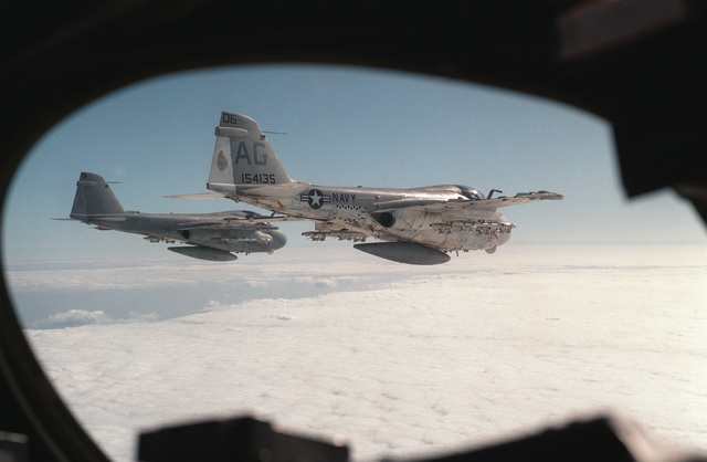An air to air right rear view of two A-6E Intruder aircraft