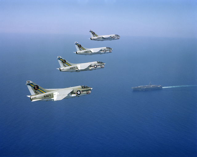 An air to air right side view of four Attack Squadron 66 (VA-66) A-7E Corsair II aircraft in formation