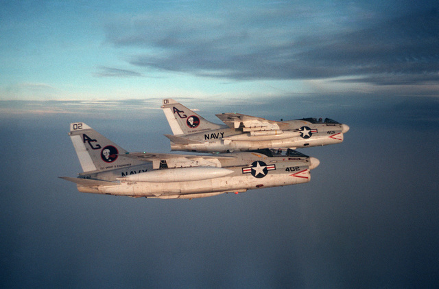 An air to air right side view of two Attack Squadron 12 (VA-12) A-7E Corsair II aircraft in formation