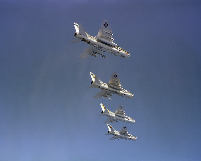 An air to air right underside view of four Attack Squadron 66 (VA-66) A-7E Corsair II aircraft in formation
