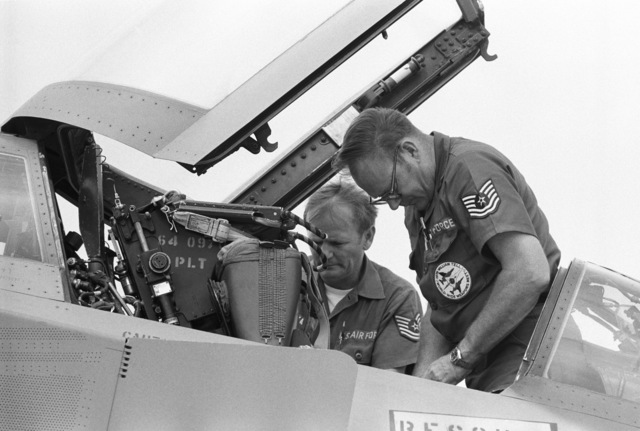 """U.S. Air Force maintenance personnel assigned to the 119th Fighter Wing""""Happy Hooligans"""", North Dakota Air National Guard, work on the ejection seat in the cockpit of a F-4D Phantom II aircraft. (A3604) (U.S. Air Force PHOTO) (Released)"""