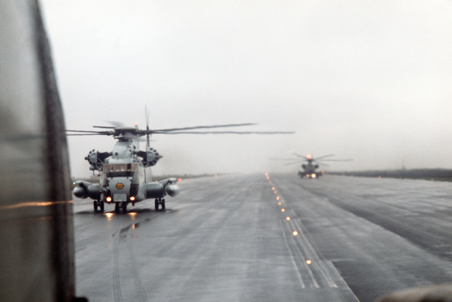 Two 39th Aerospace Rescue and Recovery Wing HH-53 helicopters shortly after landing during a stopover while en route from Eglin Air Force Base, Florida, to Woodbridge, England