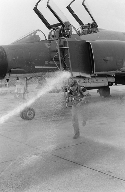 Colonel (COL) Loy is hosed down after leaving the cockpit of an 81st Tactical Figher Wing F-4C Phantom II aircraft