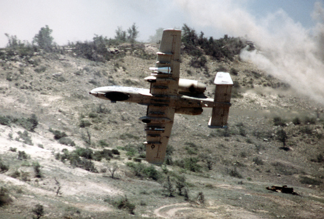 An A-10A Thunderbolt II aircraft performs low-level maneuvers over the firing range during a firepower demonstration for President Carter