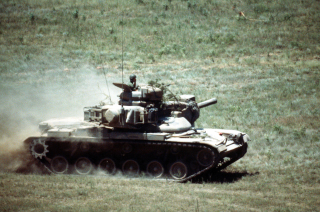 An M60A2 Main Battle Tank (MBT) maneuvers into position on the firing range during a firepower demonstration for President Carter
