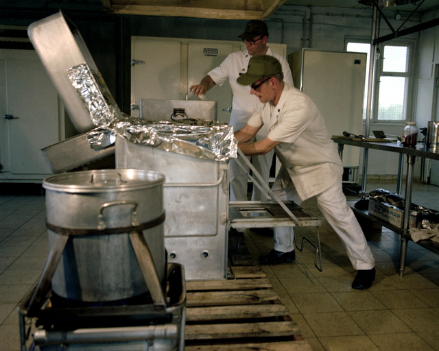 Cooks prepare meals for Co. A, 168th Armor, 157th Infantry Bde., during Reforger training exercises at the 7th Army Training Command