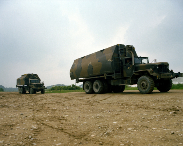 Two vehicles carrying a ribbon bridge arrived at the site where members of the 1457th Engineering Battalion will launch and assemble it during Reforger training exercises at the 7th Army Training Command