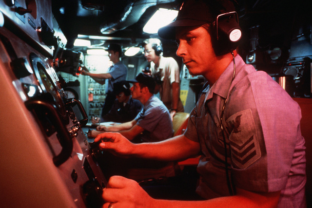 A sonar operator mans equipment in the control center of a nuclear-powered fleet ballistic missile submarine