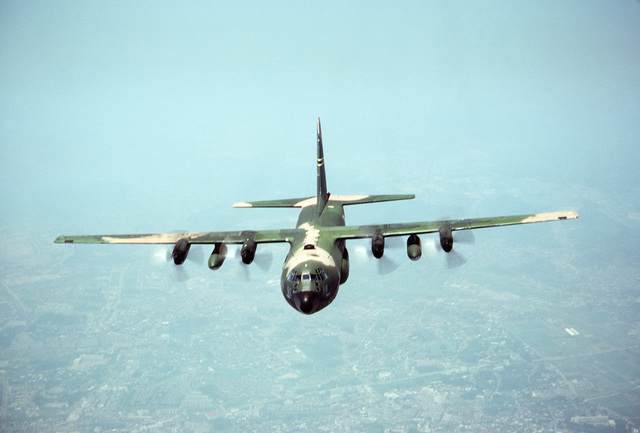 An air to air front view of a 345th Tactical Airlift Squadron C-130E Hercules aircraft