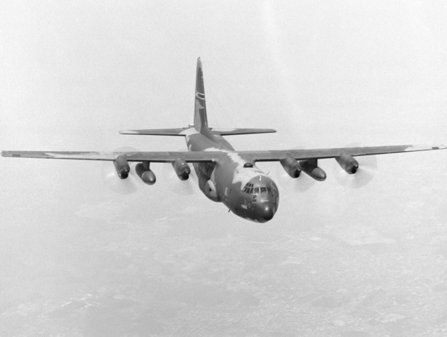 An air to air right front view of a 345th Tactical Airlift Squadron C-130E Hercules aircraft