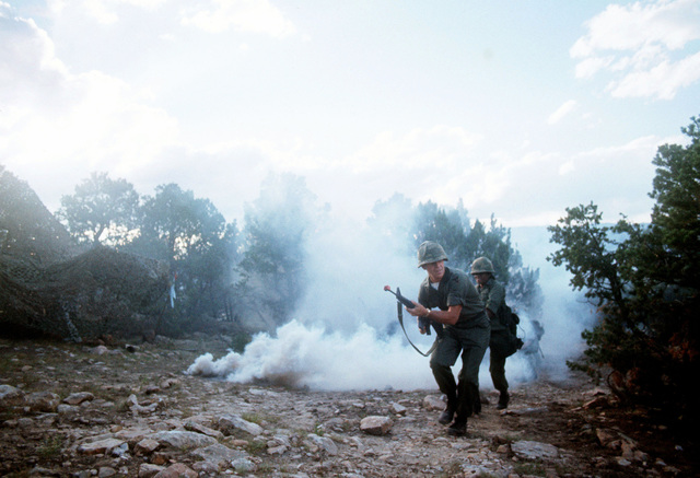 Soldiers participate in a mock battle during Joint Readiness Exercise BRAVE SHIELD XVIII