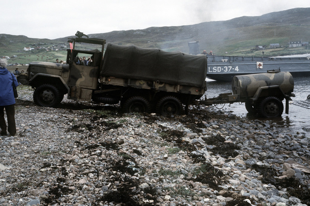 A Marine M-35 2 1/2-ton truck is too heavy for the soft wet Red Beach and sinks in the sand. The 4th Marine Amphibious Brigade is participating in the NATO exercise Northern Wedding